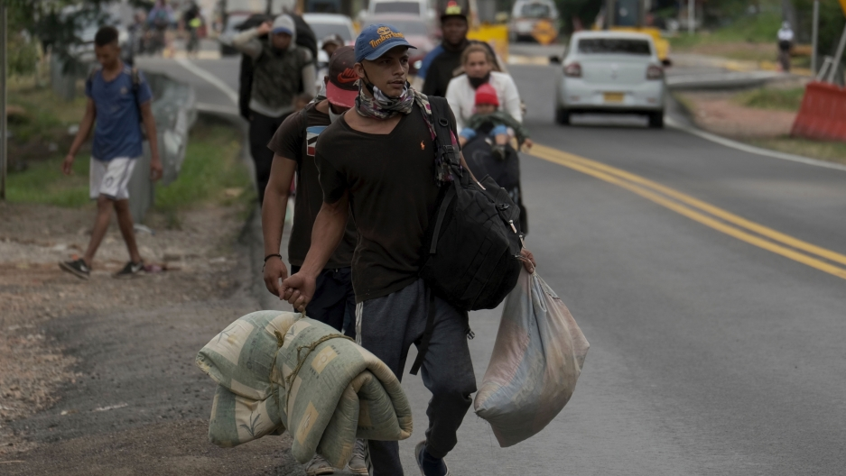 A Venezuelan migrant family walks away from the Venezuelan border in Pamplona, Colombia, Oct. 7, 2020.