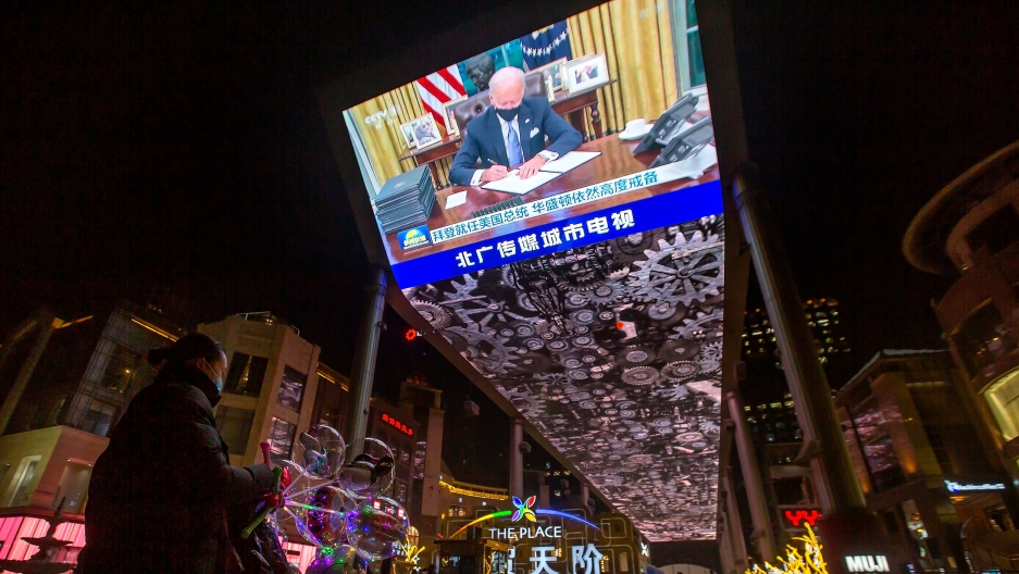 A jumbotron shown from below has newly inaugurated US President Joe Biden on screen.