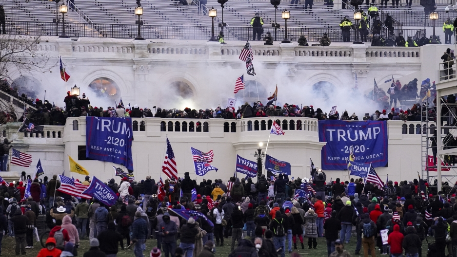 Violent protesters loyal to President Donald Trump storm the US Capitol, Jan. 6, 2021, in Washington.