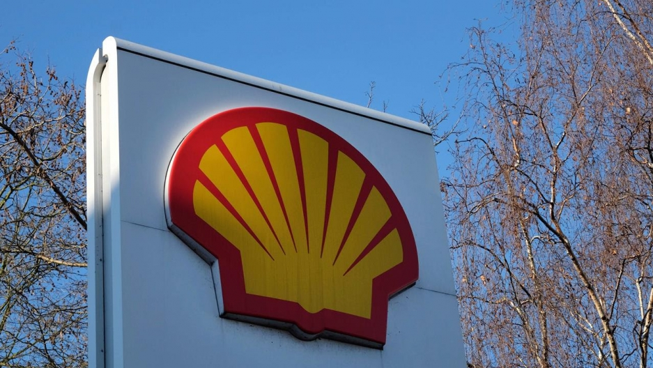 The Shell logo of a yellow shell outlined in red on a white background