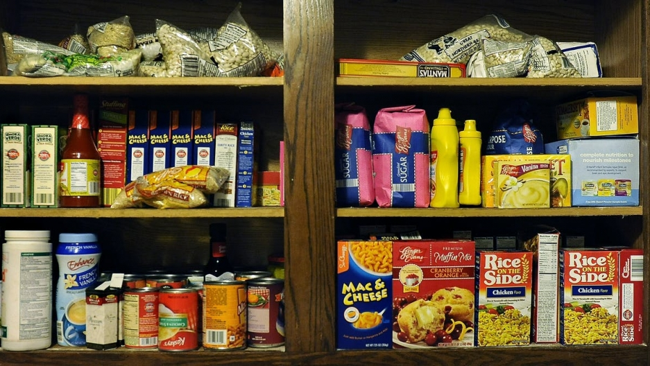 A pantry cabinet with a variety of food packages