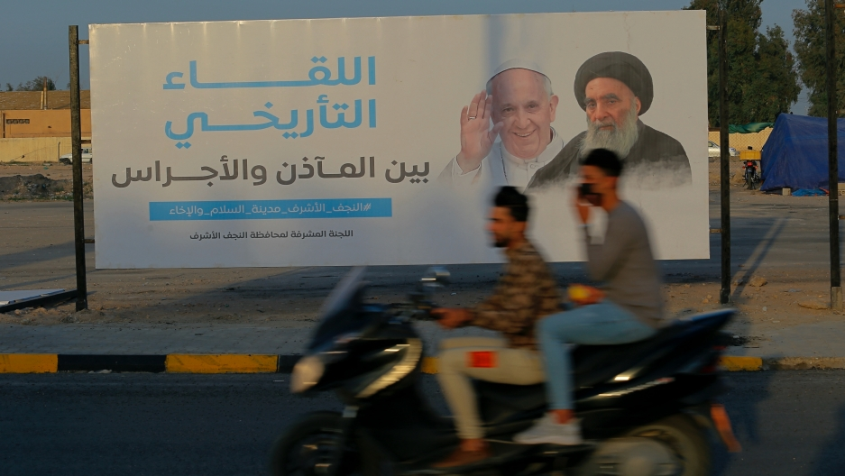 Iraqis put up a poster announcing the upcoming visit ofPope Francis and a meeting with a revered Shiite Muslim leader, Grand Ayatollah Ali al-Sistani, right, in Najaf, Iraq, March 4, 2021.