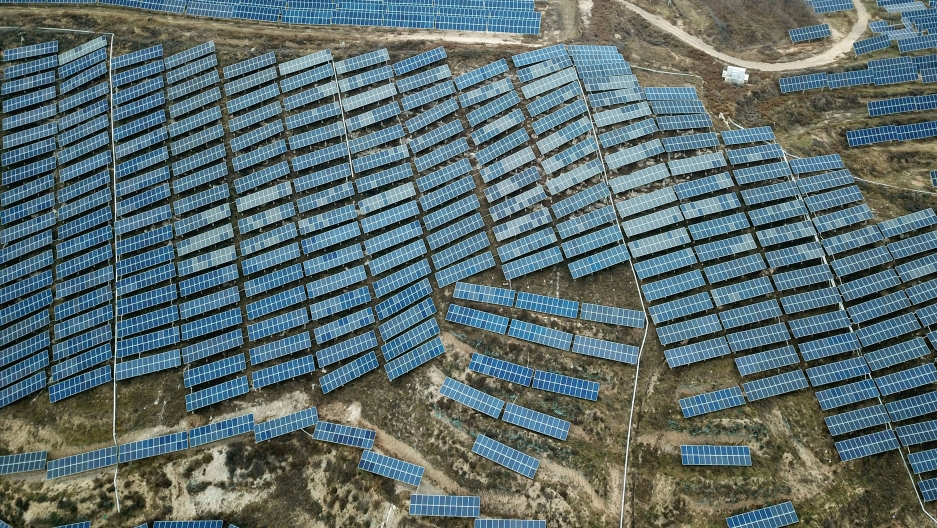 A solar panel installation is seen in Ruicheng County in central China's Shanxi Province, Nov. 27, 2019. China's Premier Li Keqiang announced that the country would target a reduction of 18% in carbon intensity over the course of the next five years as pa