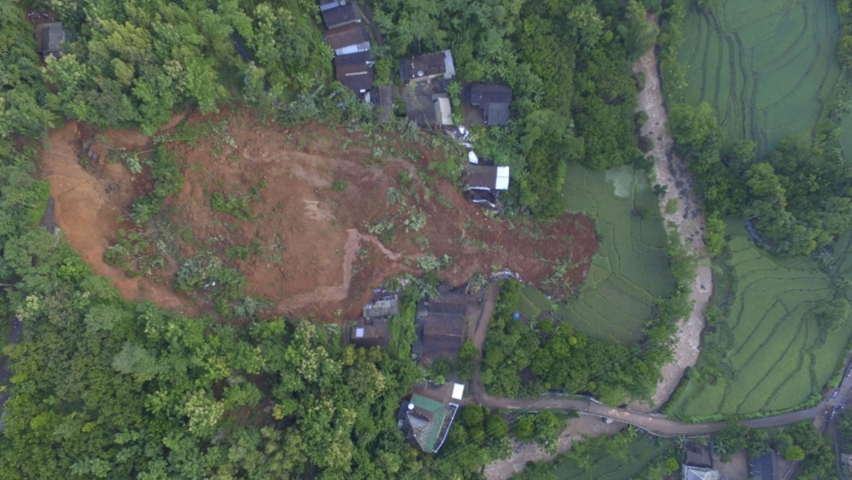 This aerial shot released by the Regional Disaster Mitigation Agency (BPBD) shows a village affected by a landslide in Nganjuk, East Java, Indonesia, Monday, Feb. 15, 2021.