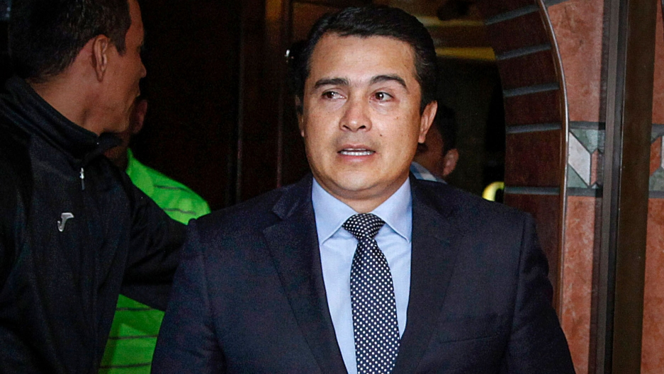 """Juan Antonio """"Tony"""" Hernández is shown wearing a blue suit and spotted tie."""