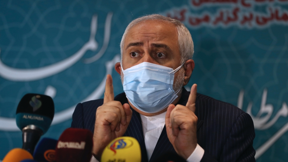 Iran's Foreign Minister Mohammad Javad Zarif speaks with journalists following a conference in Tehran, Iran, Feb. 23, 2021.