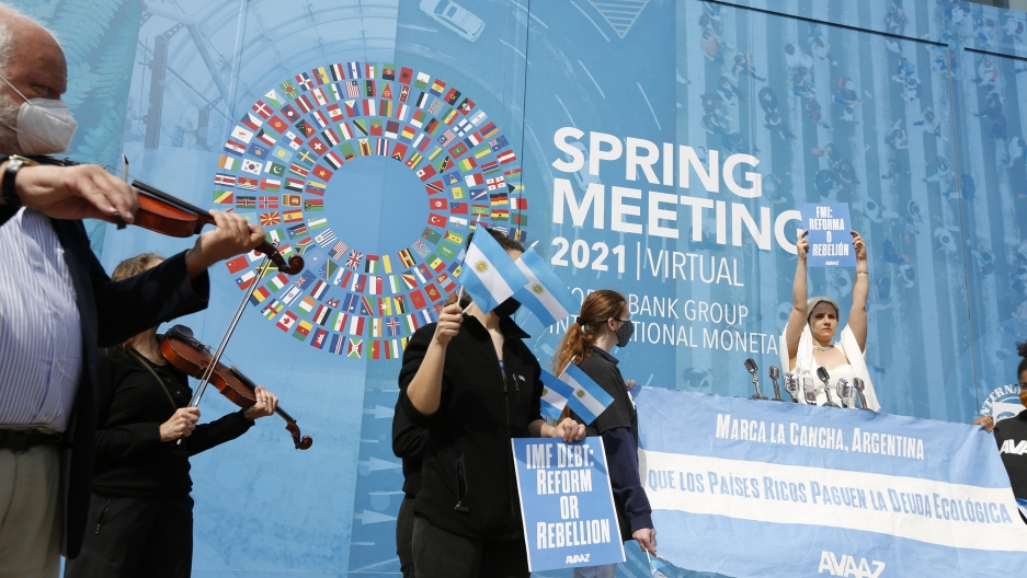"""At the entrance of the International Monetary Fund (IMF) Headquarters, an Avaaz.org activist dressed as Eva Peron —also known as Evita —sings """"Don't feed the greed Kristalina,"""" an adaptation of """"Don't cry for me Argentina"""" from the hit musical """"Evita,"""""""