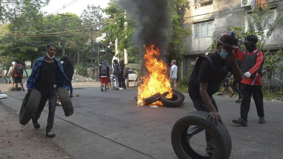 Anti-coup demonstrators gather tires to burn as they prepare to confront police during a protest in Tarmwe township, Yangon, Myanmar, April 1, 2021.