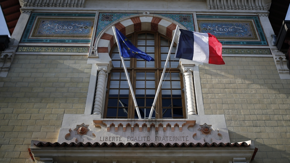 French and European Union flags fly at entrance to France's top elite school.