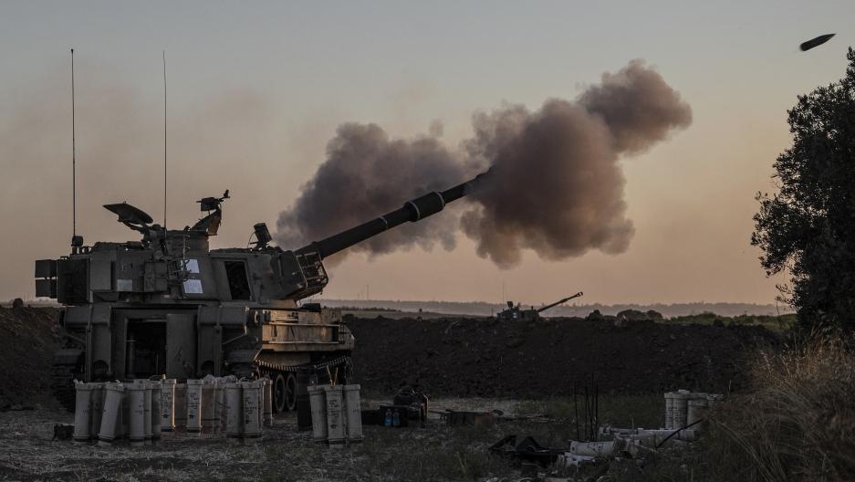 An Israeli artillery unit fires toward targets in Gaza Strip, at the Israel-Gaza border, Tuesday, May 18, 2021.
