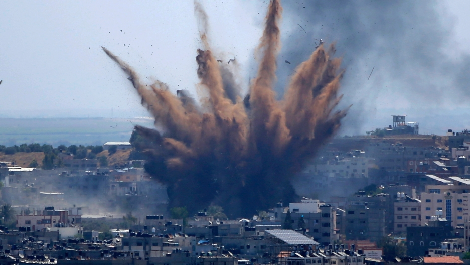 Smoke rises following Israeli airstrikes on a building in Gaza City