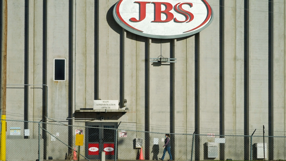 JBS red sign on meat factory building facade.
