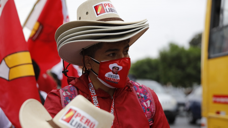 A vendor sells hats at the closing campaign rally for Free Peru party presidential candidate Pedro Castillo in Lima, Peru, Thursday, June 3, 2021. The former rural school teacher will face rival candidate Keiko Fujimori in a June 6 election.
