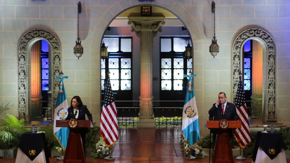 Harris at the podium in Guatemala on a diplomatic visit