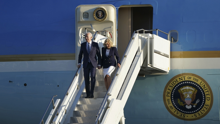 US President Joe Biden and First Lady Jill Biden arrive aboard Air Force One at RAF Mildenhall, England, ahead of the G-7 summit in Cornwall, Wednesday June 9, 2021.