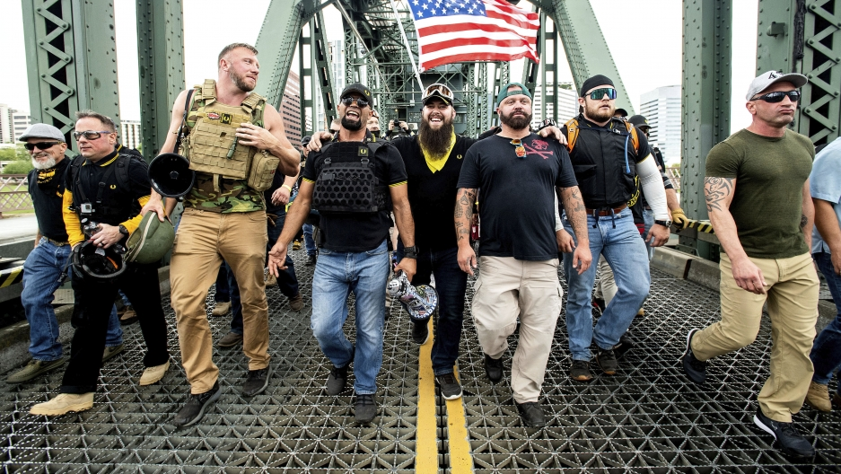 """Members of the Proud Boys and other right-wing demonstrators march across the Hawthorne Bridge during an """"End Domestic Terrorism"""" rally in Portland, Oregon, on Saturday, Aug. 17, 2019."""