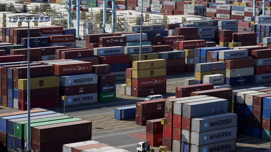 Shipping containers are stacked in the Port of New York and New Jersey in Elizabeth, New Jersey, May 20, 2021.