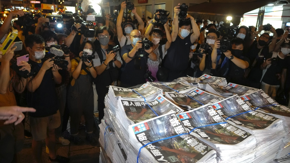 Last issue of Apple Daily arrive at a newspaper booth in Hong Kong, early Thursday, June 24, 2021.