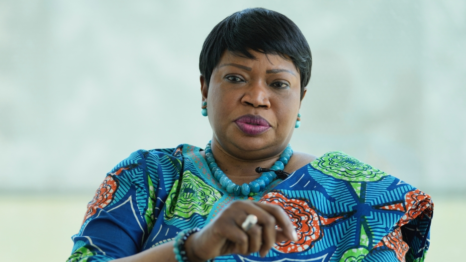 Photo of ICC Prosecutor Fatou Bensouda wearing a blue, green and orange outfit