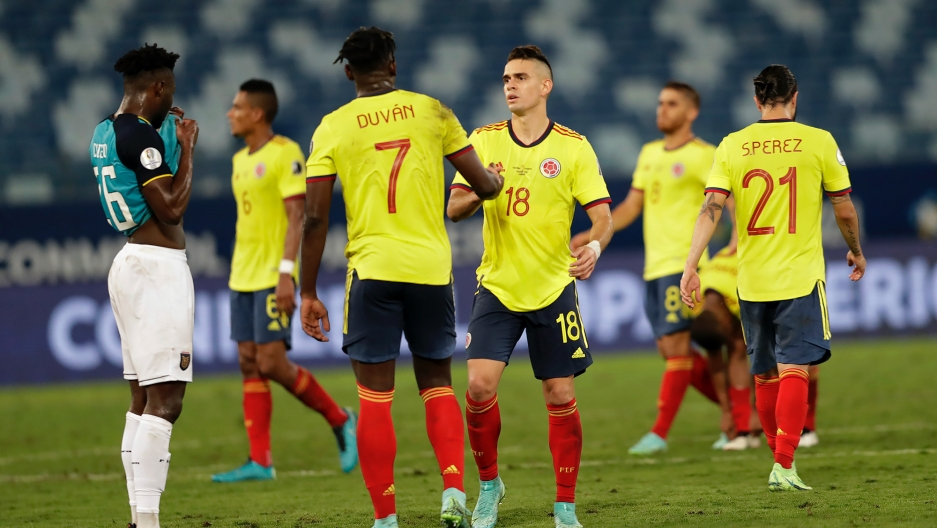 Colombia's players celebrate winning 1-0 against Ecuador during a Copa America soccer match at Arena Pantanal stadium in Cuiaba, Brazil, June 13, 2021.