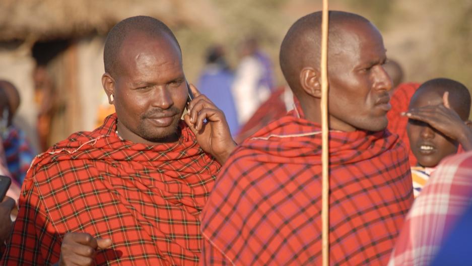 A Maasai man receives a call on his mobile phone.