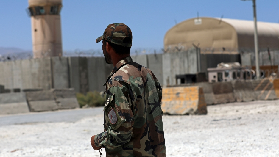 A soldier stands guard at the gate of Bagram Air Base.