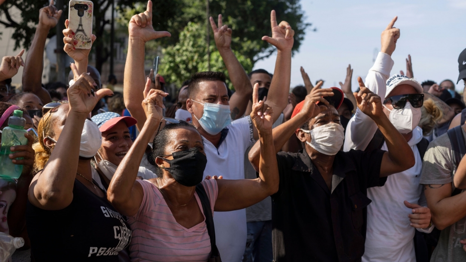 Anti-government protesters march in Havana, Cuba, Sunday, July 11, 2021.