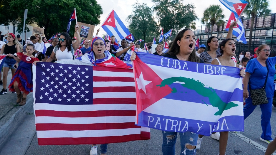 Demonstrators shout their solidarity with the Cuban people against the communist government, Thursday, July 15, 2021, in Hialeah, Florida.Hialeah has the greatest concentration of Cuban exiles in the US.