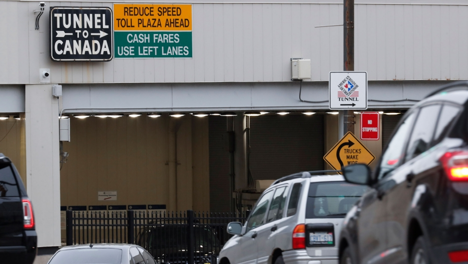 In this March 16, 2020, file photo, vehicles enter the Detroit-Windsor Tunnel in Detroit to travel to Canada.