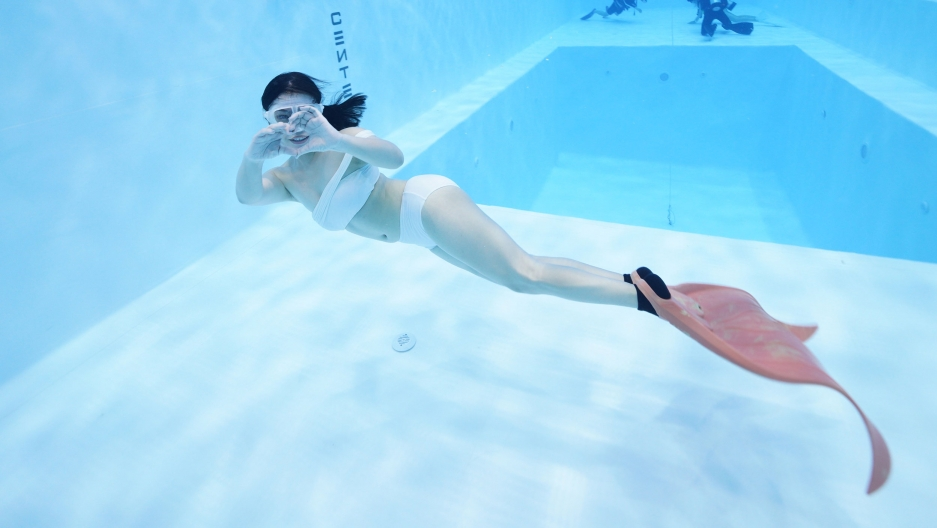 Christina Bao training underwater as a mermaid.