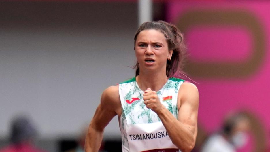 Krystsina Tsimanouskaya is shown running and wearing the track and field uniform for Belarus.