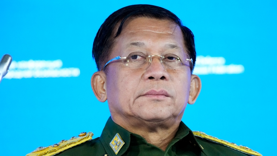 Senior General Min Aung Hlaing is shown wearing glasses and a green military uniform with gold epaulettes.