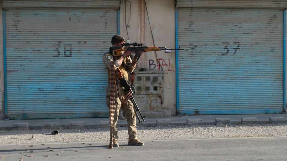 An Afghan security personnel takes a position during fighting between Taliban and Afghan security forces in Herat province, west of Kabul, Afghanistan