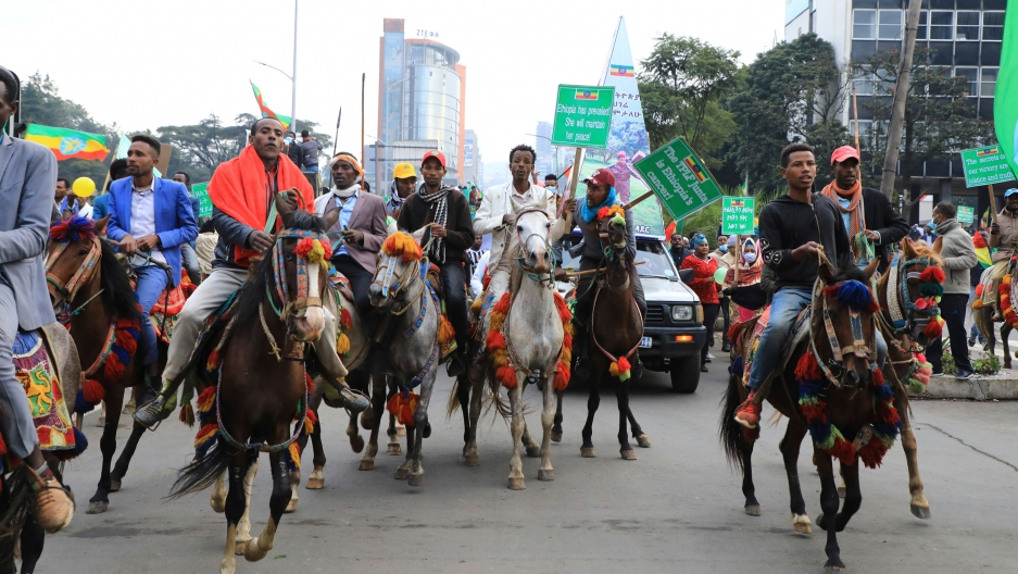 In this Sunday, Aug. 8, 2021, file photo, thousands of Ethiopians from the capital and surrounding areas head to Meskel Square to rally against the Tigray People's Liberation Front (TPLF).
