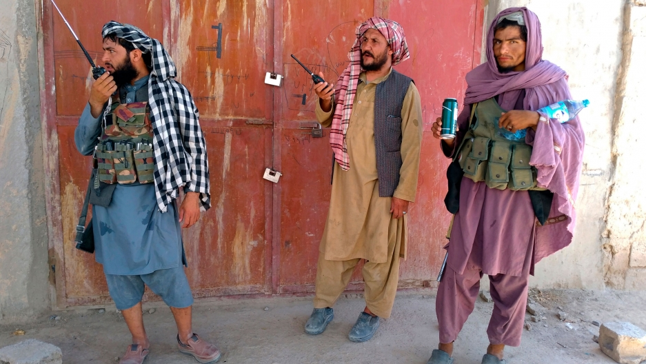 Taliban fighters stand guard at a checkpoint inside the city of Farah, capital of Farah province, southwest Afghanistan, Wednesday, Aug. 11, 2021.