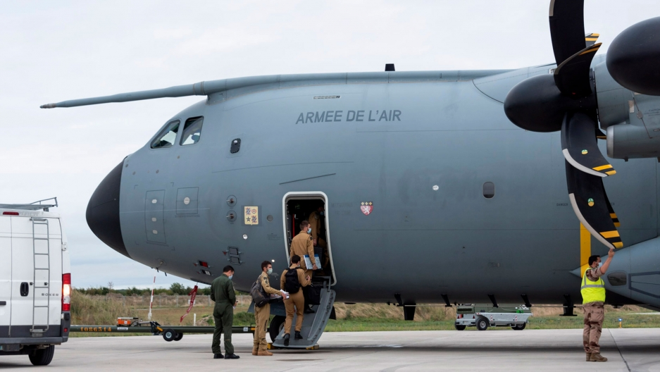 In this photo provided by the French Defense Ministry, French soldiers board a military Airbus A400M to evacuate French citizens from Afghanistan, Monday, Aug.16, 2021 in Orleans, central France.