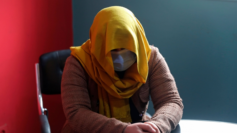 A female TV presenter from southern Afghanistan hides her identity for security concerns as she gives an interview to The Associated Press in Kabul, Afghanistan, Wednesday, Feb. 3, 2021.