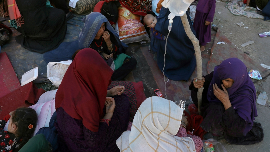 Internally displaced Afghan women from northern provinces, who fled their home due to fighting between the Taliban and Afghan security personnel, receive medical care in a public park in Kabul, Afghanistan