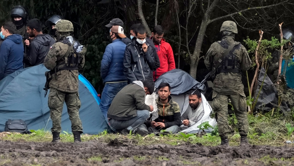 Polish security forces surround migrants stuck along with border with Belarus in Usnarz Gorny, Poland, on Wednesday, Sept. 1, 2021.