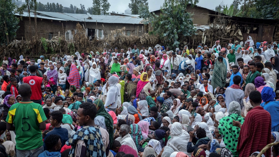 Displaced Ethiopians from different towns in the Amhara region wait for aid distributions at a center for the internally displaced in Debark, in the Amhara region of northern Ethiopia, Friday, Aug. 27, 2021.