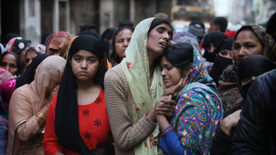 Relatives and neighbors wail near the body of Mohammad Mudasir, 31, who was killed in communal violence in New Delhi, India, Thursday, Feb. 27, 2020.