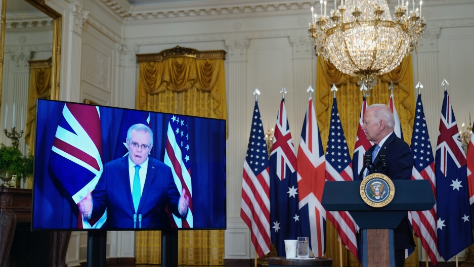 President Joe Biden listens as he is joined virtually by Australian Prime Minister Scott Morrison and British Prime Minister Boris Johnson, not seen, as he speaks about a national security initiative from the East Room of the White House in Washington, Se