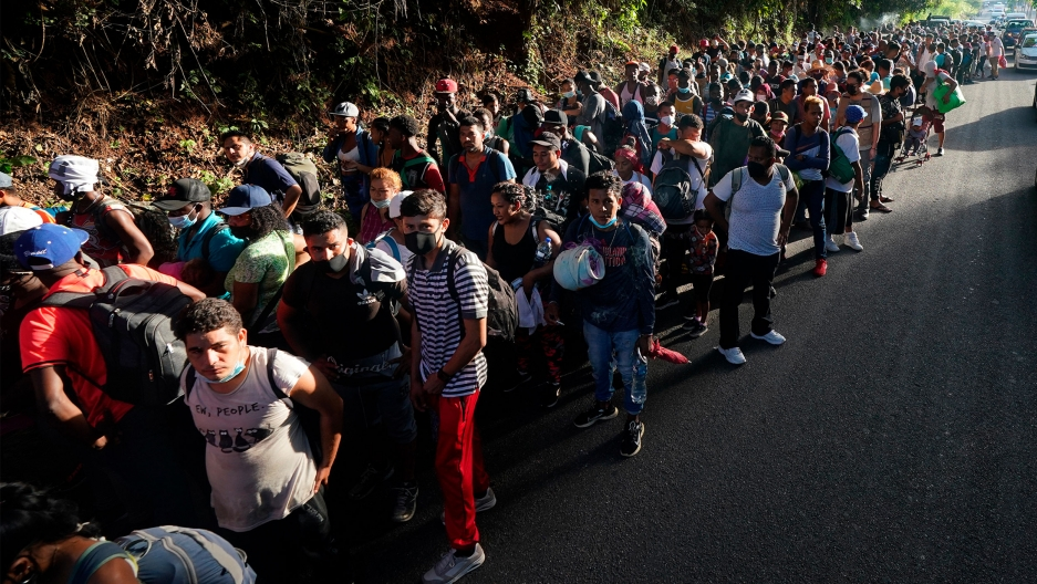 A caravan of migrants head north towards the US-Mexico border, as they depart from Tapachula, Mexico