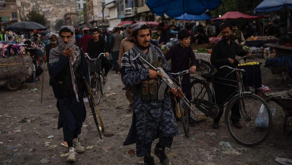 Taliban fighters patrol a market in Kabul's Old City, Afghanistan, Sept. 14, 2021.