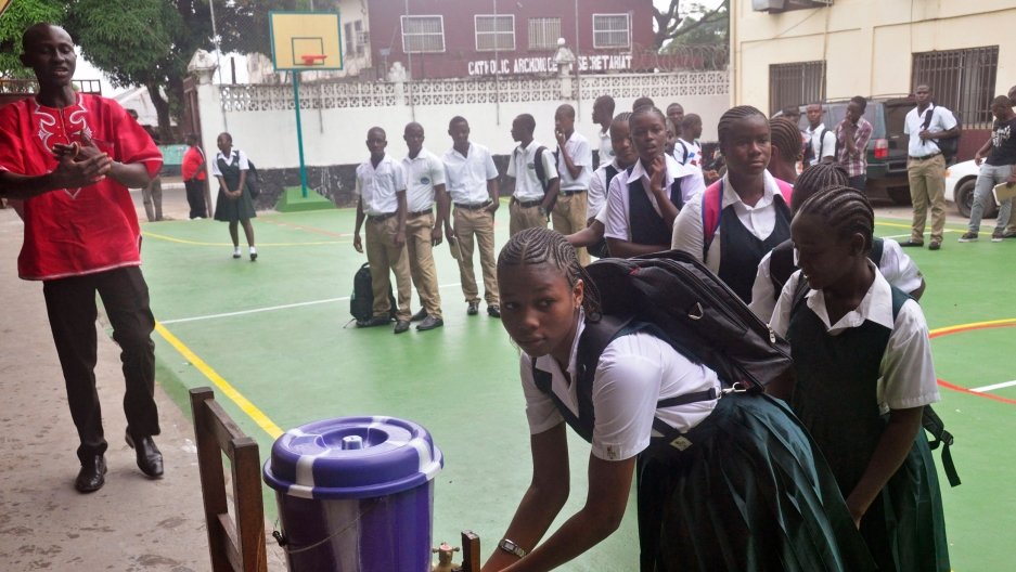 Liberian school children in the courtyard at Cathedral High School as students arrive in the morning to attend class in Monrovia, Liberia, Monday, Feb. 16, 2015.
