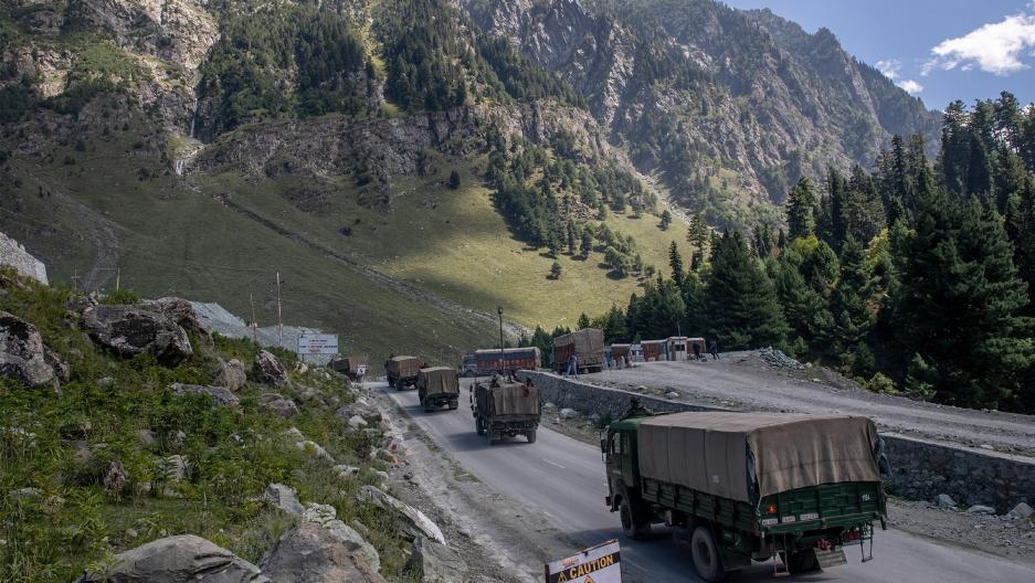 An Indian army convoy moves on the Srinagar- Ladakh highway at Gagangeer, northeast of Srinagar, Indian-controlled Kashmir
