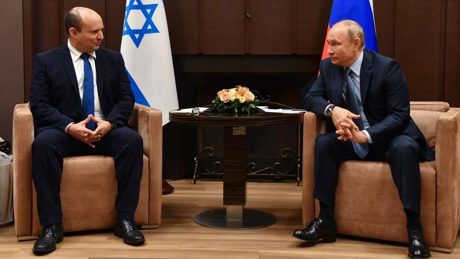 Russian President Vladimir Putin, right, and Israeli Prime Minister Naftali Bennett speak during their meeting in Sochi, Russia, Friday, Oct. 22, 2021.