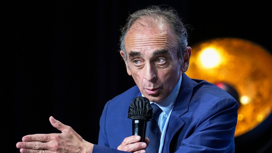 Hard-right political talk-show star Eric Zemmour gestures as he talks during a meeting to promote his latest booki