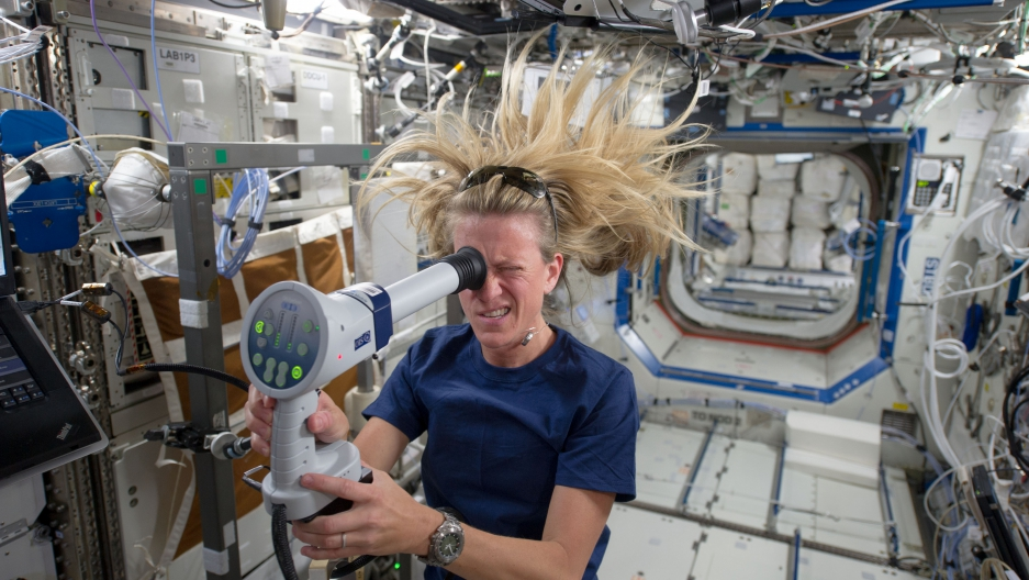 NASA astronaut Karen Nyberg uses a fundoscope to image her eye while in orbit. Photo by NASA