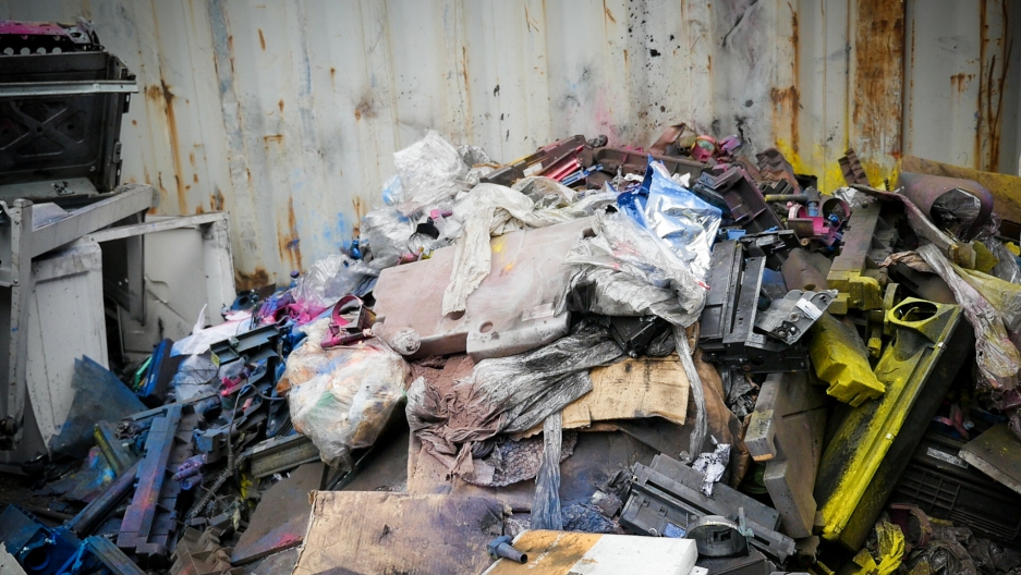 A pile of printer parts dusted with toners like carbon black, a probable carcinogen known to cause respiratory problems.